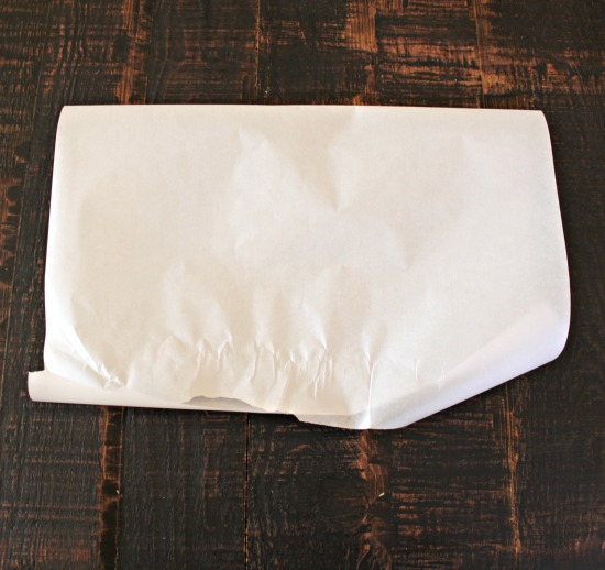 Fold parchment in half