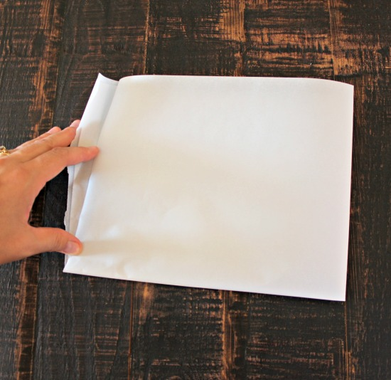 Fold parchment paper in half again